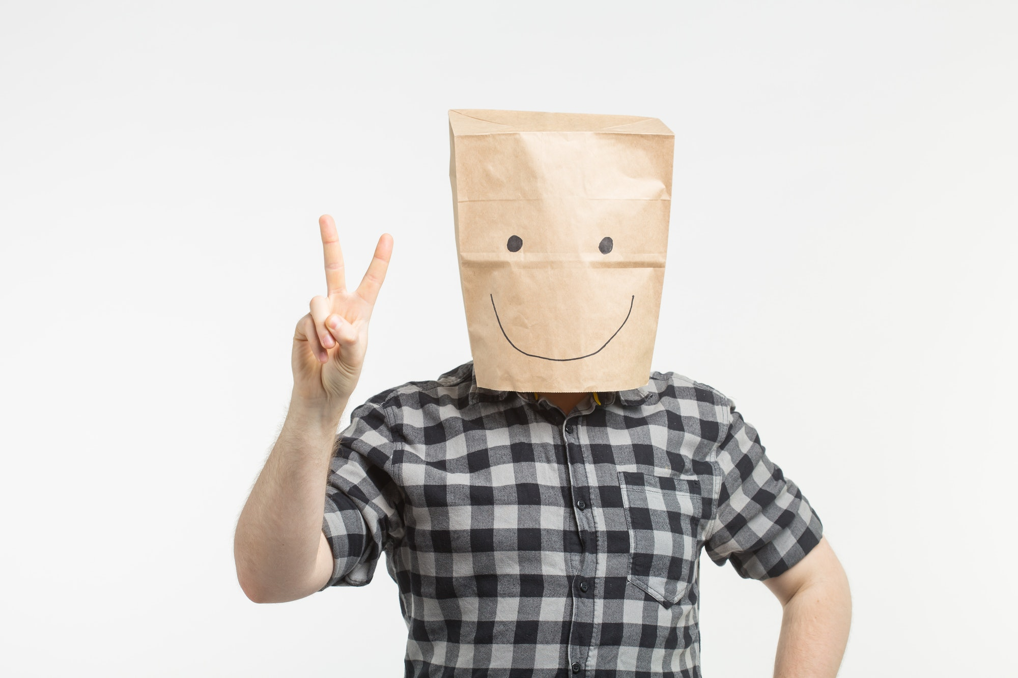men in paper bag mask hiding identity